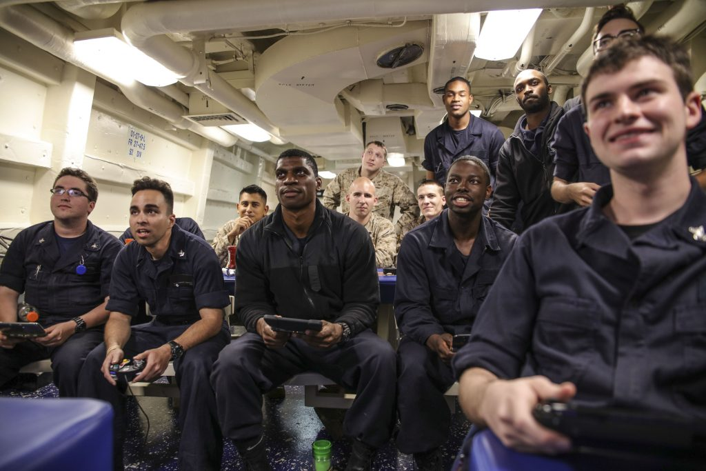 active duty military taking a break from the stresses of service playing video games